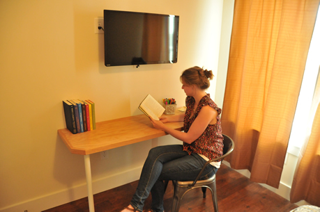 <b>Custom built-in desk</b> - Local Bloomington carpenter Rod Lucas custom built every desk at SummerHouse. It's a great spot for catching up on some work or reading a book.
