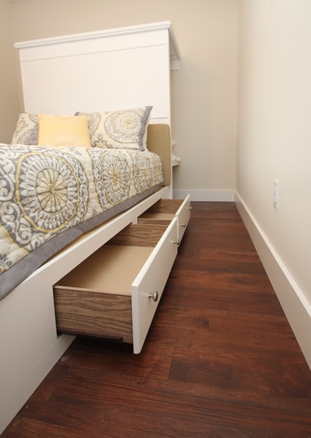 <b>A bed frame that's also a dresser</b> - Ditch living out of a suitcase. 4 large drawers for storing all your foldable clothes.